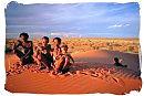 Bushmen family in the desert