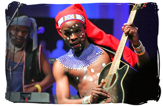 Young guitar player enjoying himself - Xhosa Tribe, Xhosa Language and Xhosa Culture in South Africa