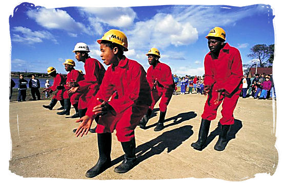 Mine workers performing the popular miners Gumboot Dance - South Africa dance