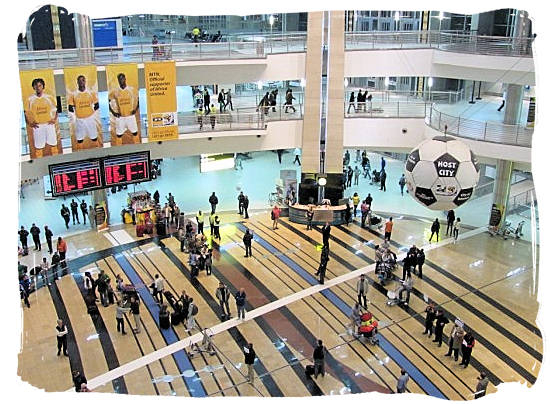 Central area between the various terminals inside the OR Tambo Airport building - Cheap Flights to Johannesburg Airport South Africa