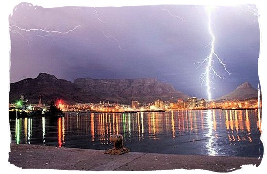 Cape Town harbour and Table Mountain lit up by lightning - Cape Town weather forecast, South Africa weather facts