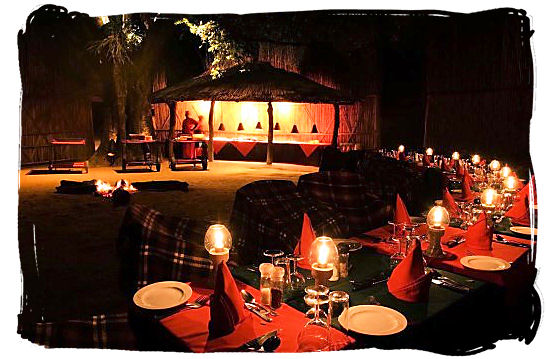 An exquisite bushveld dinner is awaiting in the boma at Mala Mala private game reserve