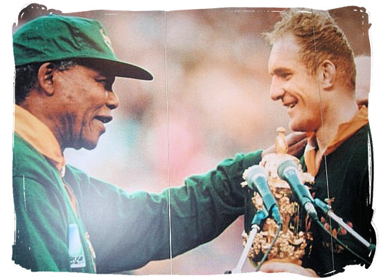 =Nelson Mandela, South Africa's president of South Africa at the time, congratulates Springbok captain Francois Pienaar with his team winning the Rugby World Championship in 1995 - Big 3 of South African Sports, South Africa Sports Top Ten