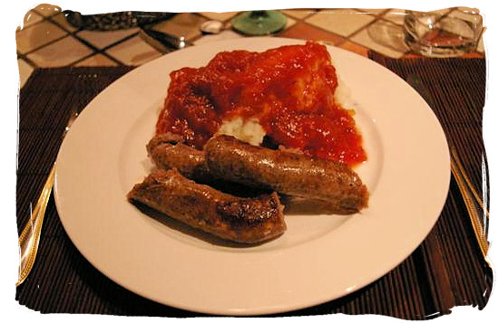 "Mieliepap, boerewors en sous"" maize porridge, sausage and sauce, a favourite with all South Africans - South Africa's Traditional African Food"