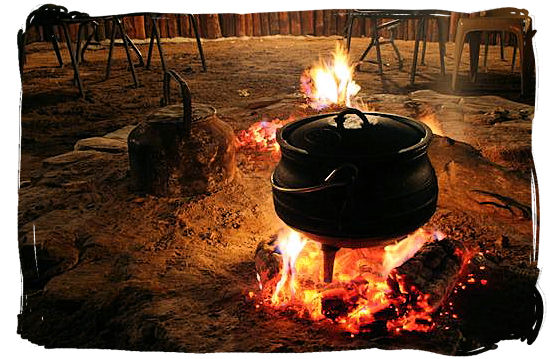 Heating up the potjie - pot food (Potjiekos) in South Africa