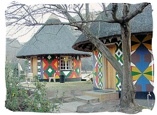 Rondavels in the Glen Reenen rest camp decorated with the traditional painting of the Basotho people - Golden Gate Highlands National Park