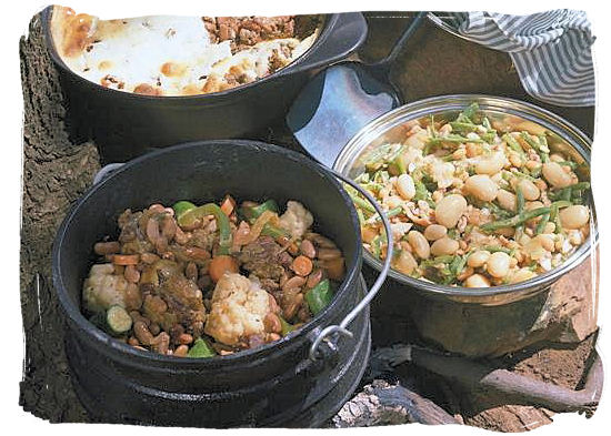 Potjiekos, legacy of the early Dutch settlers, who used to cook stew in a pot over an open fire - South Africa food history and culture