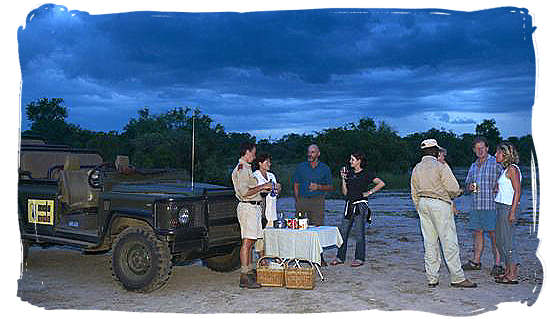 Enjoying sundowners on a game drive in the Mala Mala private game reserve.