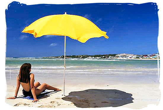 Lazing in the sunshine on one of Cape Town's famous beaches - Cape Town weather forecast, South Africa weather facts
