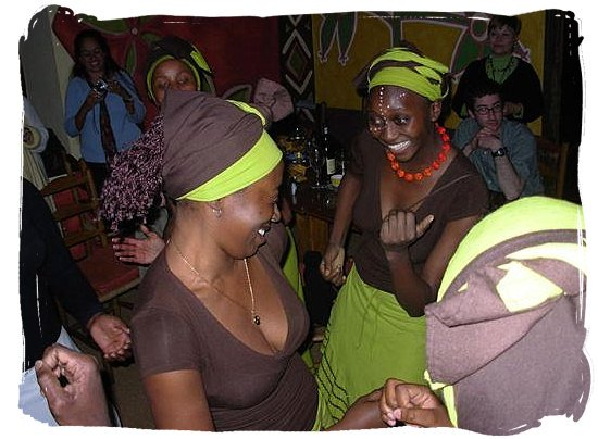 Dancing waitresses at the Africa Café, traditional Africa restaurant in Cape Town - South Africa's Traditional African Food