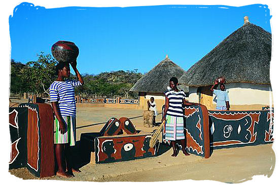 Venda ladies at the entrance of a cultural village - Black People in South Africa, Black Population in South Africa
