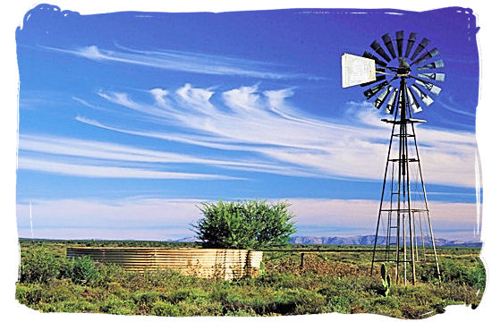 Lonely windmill in the Great Karoo pumping up precious water from underground - The Great Karoo Climate, Karoo National Park South Africa