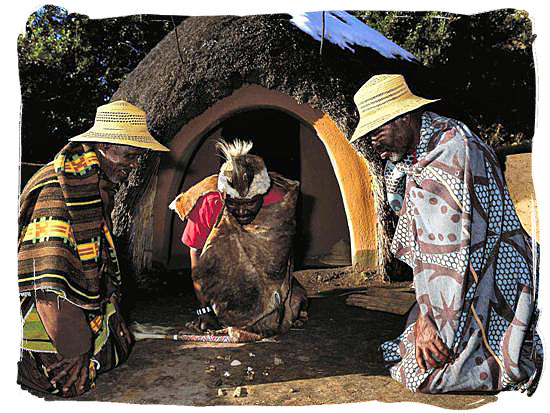 A witch doctor throwing the bones to consult the ancestral spirits - ancient Africa history