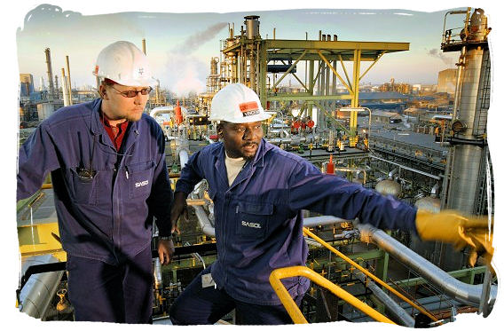 Workers at a Sasol plant in South Africa, the world's largest synthetic fuels producer - South African national anthem