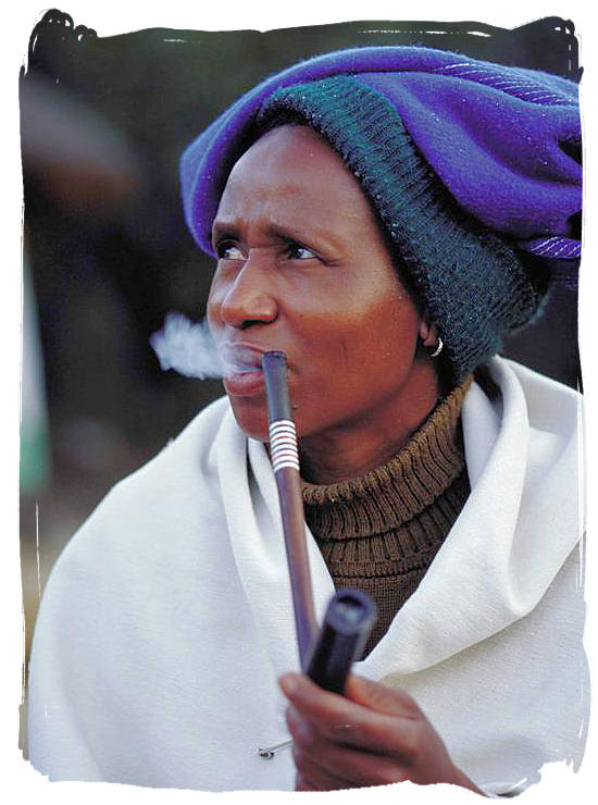 Xhosa lady enjoying her pipe at the lesedi cultural village - Black People in South Africa, Black Population in South Africa