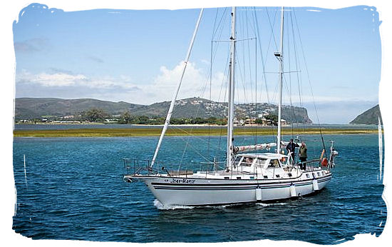 Yachting in the lagoon with the heads showing up in the far distance - Knysna Activities, Attractions and Festivals in South Africa