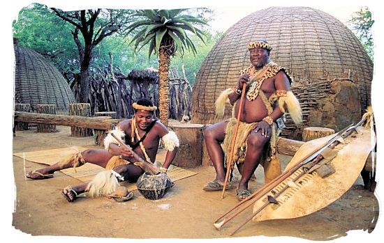 Zulu's in front of hut with weapons at Shakaland cultural museum - Ode to Kwazulu Natal Province, Tourism, South Africa
